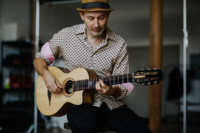 man playing Gypsy Parlor Guitar   Kazourian Luthier